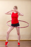 Fit woman with hula hoop doing exercise Stock Image