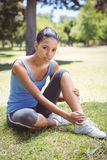 Fit woman with injured ankle Stock Photography