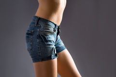 Fit woman in jeans shorts Stock Photos