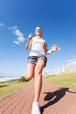Fit woman jogging Stock Photos