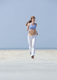 Fit  woman jogging outdoors Royalty Free Stock Photography