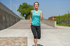 Fit woman jogging in park. Royalty Free Stock Images