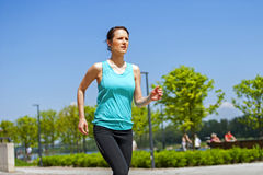 Fit woman jogging in park. Stock Image