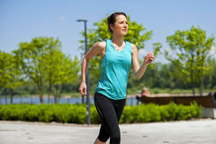 Fit woman jogging in park. Royalty Free Stock Photo