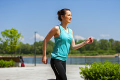 Fit woman jogging in park. Royalty Free Stock Photography