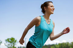 Fit woman jogging in park. Royalty Free Stock Photos