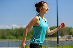 Fit woman jogging in park. Stock Photography