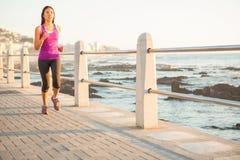 Fit woman jogging at promenade Royalty Free Stock Image