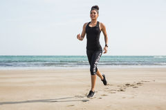 Fit woman jogging on the sand Royalty Free Stock Images
