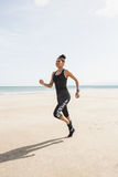 Fit woman jogging on the sand Royalty Free Stock Photo