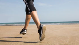 Fit woman jogging on the sand Royalty Free Stock Photography