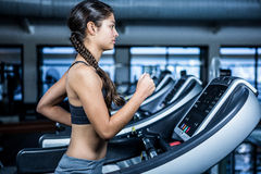 Fit woman jogging on treadmill Stock Photos