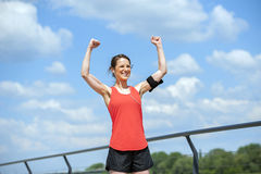 Fit woman jump happy of victory winns. Royalty Free Stock Image
