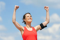 Fit woman jump happy of victory winns. Stock Photo
