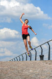 Fit woman jump happy of victory winns. Stock Photography