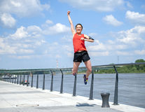 Fit woman jump happy of victory winns. Royalty Free Stock Photography