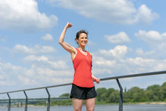 Fit woman jump happy of victory winns. Stock Image