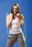 Fit woman with jumping rope Stock Photo