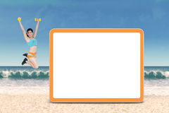 Fit woman jumps near copyspace Royalty Free Stock Photos