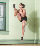 Fit Woman Kicking Mid Air Stock Images