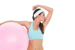 Fit woman kissing muscles  with fitness ball Royalty Free Stock Image