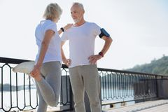 Fit woman leaning on husband while stretching Royalty Free Stock Image