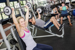 Fit woman lifting barbell royalty free stock photos