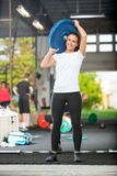 Fit Woman Lifting Barbell Plate Royalty Free Stock Photography