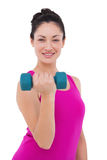 Fit woman lifting blue dumbbell Royalty Free Stock Image