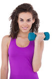 Fit woman lifting blue dumbbell Royalty Free Stock Images