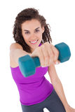 Fit woman lifting blue dumbbell Royalty Free Stock Photo