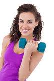 Fit woman lifting blue dumbbell Royalty Free Stock Photography