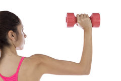 Fit woman lifting dumbbell Stock Photos