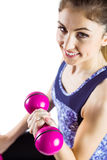 Fit woman lifting dumbbell sitting on ball Royalty Free Stock Images