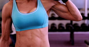 Fit woman lifting dumbbells at crossfit session stock footage