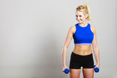Fit woman lifting dumbbells weights Royalty Free Stock Photo