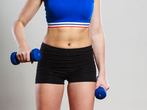 Fit woman lifting dumbbells weights Stock Photo