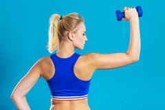 Fit woman lifting dumbbells weights Stock Images