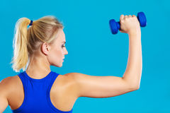 Fit woman lifting dumbbells weights Royalty Free Stock Photos