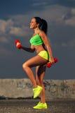 Fit woman lifting dumbbells Stock Photos