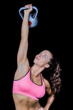 Fit woman lifting kettlebell Stock Image