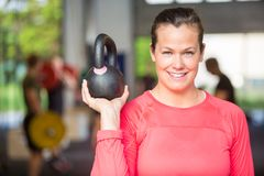 Fit Woman Lifting Kettlebell At Gym Royalty Free Stock Images