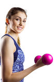 Fit woman lifting pink dumbbell Stock Images