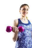 Fit woman lifting pink dumbbell Royalty Free Stock Photos