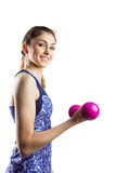 Fit woman lifting pink dumbbell Royalty Free Stock Photo