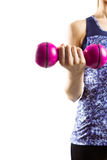 Fit woman lifting pink dumbbell Stock Image