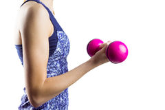 Fit woman lifting pink dumbbell Stock Photo