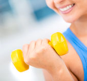 Fit woman lifting weights Stock Photo