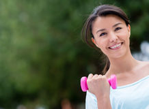 Fit woman lifting weights Stock Image