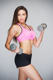 Fit Woman Lifting Weights Stock Images